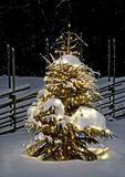 Christmas tree at night. With snow and old style fence Royalty Free Stock Images