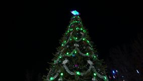 Christmas tree at night decorated with lights. Christmas tree at night decorated stock footage