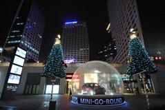 Christmas tree with minicooper car at night Stock Image
