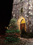 Christmas tree at night outside church Stock Photography