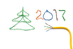Christmas tree, number 2017 made from cables of Twisted pair RJ45 and yellow patch cord for Lan network. Royalty Free Stock Photos