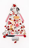 Christmas tree of old and antique miniatures in red, silver and stock photo