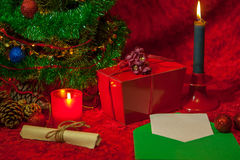 Christmas Tree with open envelope, paper and burning candle Royalty Free Stock Images