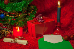 Christmas Tree with open envelope, paper and burning candle Stock Photos