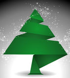 Christmas Tree origami. Origami Christmas tree from green paper on a dark background starry Royalty Free Stock Photos