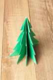 Christmas tree origami on wood background. Photo vector illustration