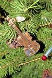Christmas tree ornament. Macro violin ornament on Christmas tree Royalty Free Stock Image