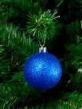 Christmas Tree Ornament. A Christmas ornament hanging on a Christmas tree Stock Photos