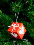 Christmas Tree Ornament. A red christmas ornament hanging on a Christmas tree Stock Photo