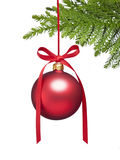 Christmas Tree Ornament Background. A red christmas ornament on a tree isolated on a white background stock photography