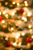 Christmas Tree Ornament Background. Colorful ornaments and christmas decoration on green tree blurred to be used as background or texture Royalty Free Stock Image