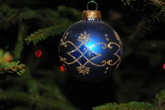 Christmas tree ornament. Blue Christmas tree ornament hanging in Christmas tree stock photography