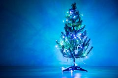 Christmas tree ornament with blue color light.  stock photo