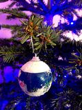 Christmas tree ornament. A branch of Christmas tree once stood a small globe Royalty Free Stock Image