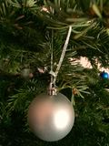 Christmas tree ornament. A branch of Christmas tree once stood a small globe Royalty Free Stock Photo