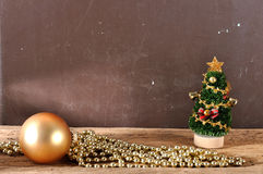Christmas tree ornament and decorations on wooden plank Royalty Free Stock Photos