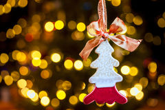 Christmas tree ornament. A Christmas tree ornament with holiday lights in the background stock photos