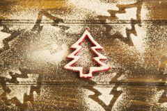 Christmas tree ornament with icing sugar on wooden background,to Royalty Free Stock Images