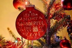 Christmas tree ornament with inscription. It`s the most wonderful time of the Year royalty free stock image