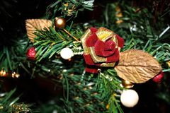 Christmas tree ornament. Red and gold rose bud Christmas tree ornament Royalty Free Stock Images