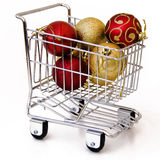 Christmas tree ornament in shopping cart. Isolated Royalty Free Stock Image