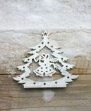 Christmas tree ornament in a snow background Royalty Free Stock Photography