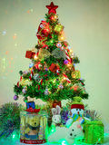 Christmas tree ornamented on the night Stock Images