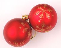 Christmas Tree Ornaments. Two red christmas tree ornaments Royalty Free Stock Photo