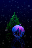 Christmas tree with ornaments. On black background with a cold, wintery feel. HQ studio shot Stock Photography