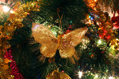 Christmas tree ornaments, bright shiny butterfly. Illuminations royalty free stock images