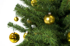 Christmas tree ornaments. Christmas tree with golden globes ornaments stock image