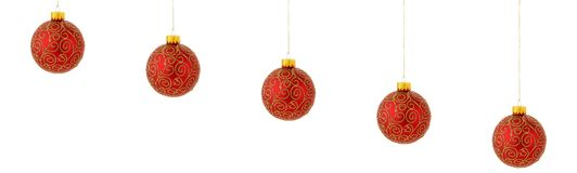 Christmas tree ornaments hanging on white Royalty Free Stock Photography