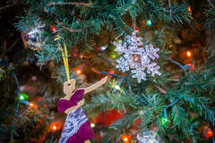 Christmas Tree Ornaments. A lady points to a snow flake on a Christmas tree Royalty Free Stock Photo