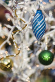 Christmas tree ornaments with lights on a white tree Stock Photo