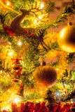Christmas  tree with ornaments. Christmas tree with ornaments and many colorful lights with bokeh Royalty Free Stock Photography