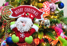 Christmas tree ornaments and Merry Christmas sign Stock Images