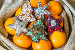 Christmas tree ornaments and oranges in sack Royalty Free Stock Image