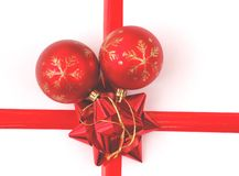 Christmas Tree Ornaments,Ribbons and a Bow. Two red christmas tree ornaments with red ribbons and a bow Stock Image