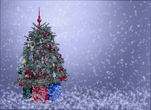 Christmas tree with ornaments on silver snowy background. Stock Photography
