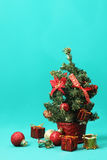 Christmas tree ornaments on tree against blue background Stock Images