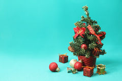 Christmas tree ornaments on tree against blue background - Series 2 Royalty Free Stock Photo
