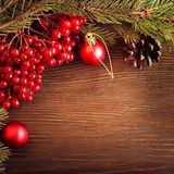 Christmas tree ornaments and viburnum berries Royalty Free Stock Photos