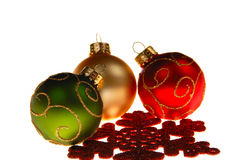 Christmas tree ornaments on white background. Ready for the holiday season. White space for text. Shallow depth of field Royalty Free Stock Image