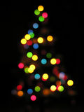 Christmas tree out of focus. On dark Stock Photo