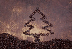 A christmas tree out line made out of  roasted coffee beans Stock Photos