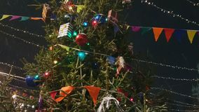 Christmas tree at the outdoor market. In old city stock video