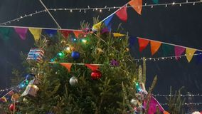 Christmas tree at the outdoor market. In old city stock footage