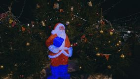 Christmas tree at the outdoor market. Santa near christmas tree at the outdoor market in old city stock video