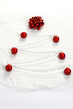 Christmas tree painted in snow with red bow and red matt christmas balls Stock Photo
