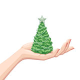 Christmas tree on a palm. A green christmas tree on a palm; vector illustration on white background Royalty Free Stock Images